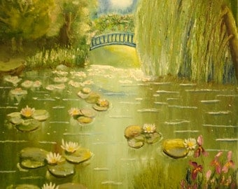 Lily pads in the park with bridge