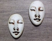 Pair of Two Medium Almond Ceramic Face Stone Cabochons in Dry Bone and Metallic Iron