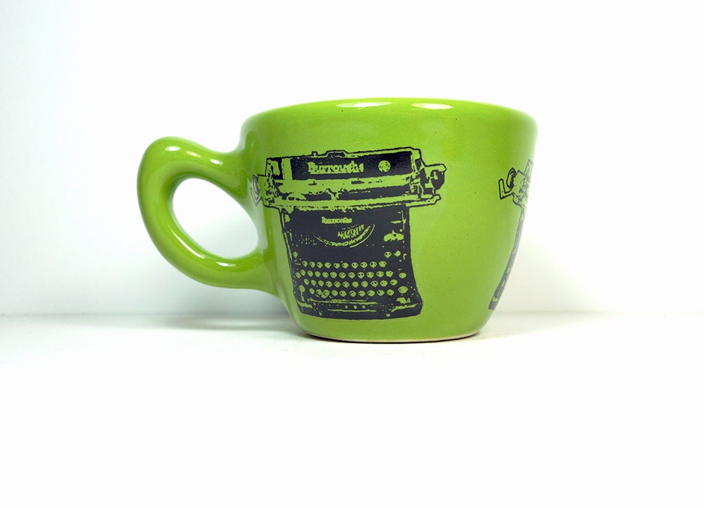 12oz cup with a Burroughs typewriter print, shown here on Avocado Green - Made to Order / Pick Your Colour