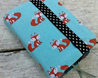NWT reversible Bible cover, Cute little foxes on blue background, pocket sized.