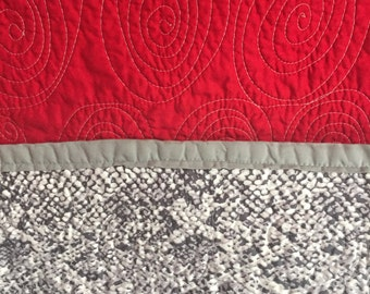 Double sided whole cloth quilt -- snakeskin and red with spiral stitching --
