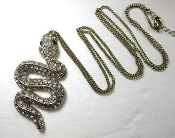 SJK Vintage --  Egypt Revival Rhinestone Snake Pendant Necklace (1970's-80's)