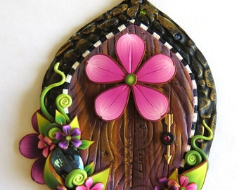 Pink Flower Fairy Door with a Big Sparkling Gem.