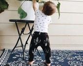 Cactus print baby leggings on black spandex jersey, hand stamped