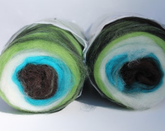 Merino wool self striping center pull roving bump. 2 bumpsTons of color changes Weighs 8oz. Free Ship SALE