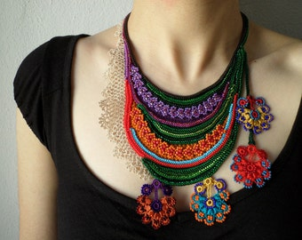 fiber art necklace - freeform crochet - lilac, red, green, orange, blue - beaded necklace with colorful flowers