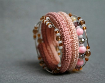 Crochet memory wire wrap bracelet in different shades of pink