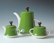 set of vintage porcelain teapot or coffee pot; sugar, creamer with tin cozy in olive green