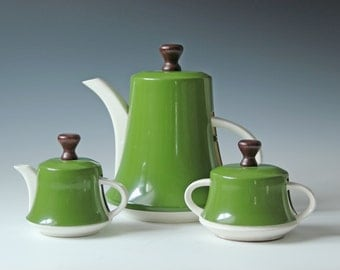Set of vintage porcelain teapot or coffee pot; sugar, creamer with tin cozy in olive green - retro modern tableware