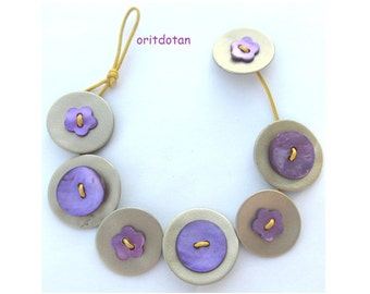 Bracelet button jewelry made of shell flowers buttons purple shade on leather cord