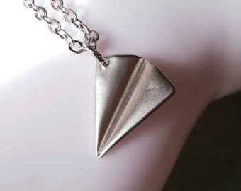 Airplane necklace. Little silver airplane charm necklace. Silver plated jewelry. 3D folded origami airplane silver paper aircraft travel
