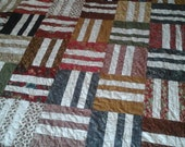 King size green,  gold,  red and gray quilt