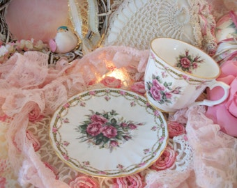 vintage fine bone china teacup and saucer, dainty pink rose bud garlands, sweet cottage chic styling, swagged roses, england. petite size