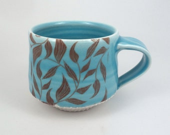 Blue glazed porcelain mug with leaf pattern and dotted texture (#1)