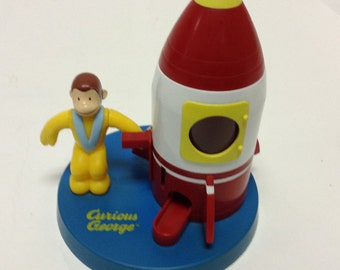 CURIOUS GEORGE rocket ship gumball machine toy