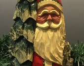 HAND CARVED original bright red Santa with tree from 100 year old Cottonwood Bark.