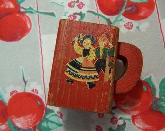 tiny wooden swiss vase