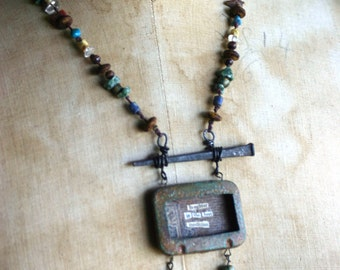 Laughter is the Best Medicine upcycled aspirin tin necklace- published in Jewelry Affaire magazine
