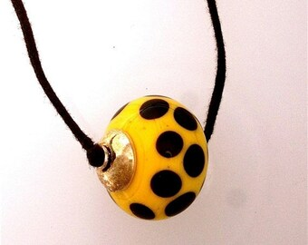 Summer Sale Yellow and Black Lamp Work Glass Bead on Two Knot Cord
