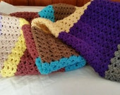 Colorful crocheted striped blanket throw