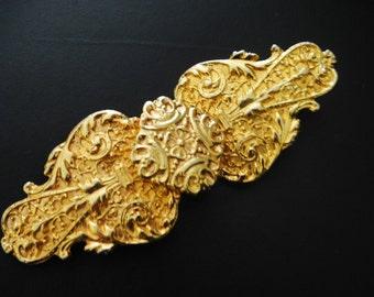 Art deco vintage80s gold tone metal , ornate, large belt buckle. Made by Gay Boyer.