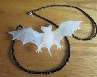 glow in the dark lily monster necklace