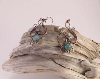 Copper wire wrap with green beads.