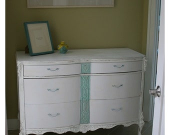 Vintage dresser with carved detail