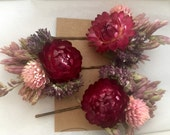 Gift set of 3 colorful bobby pins adorned with dried flowers in shades of pink and magenta.