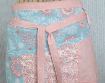 Vendor apron with zippered pocket Aqua and coral