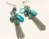 Blue turquoise colored abalone sea shell chain tassels earrings.
