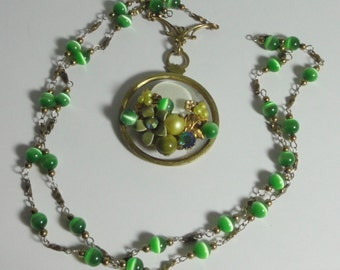 Hand Crafted Gold tone metal, Green Moon Glow Beads with Antique decorated Monocle Pendant Necklace.