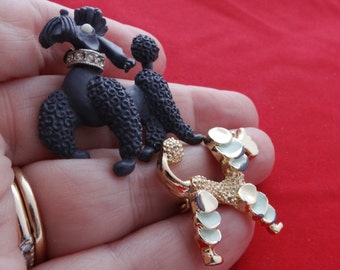 """Pair of vintage Vintage poodle brooches in great  condition, gray is signed JJ and 1.5"""" gold tone is 1.25"""""""