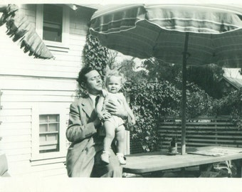 Father And Daughter 1940s Curly Hair Blonde Held Outside 40s Vintage Black and White Photo Photograph