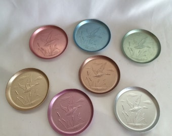 7 Vintage Anodized Aluminum Flying Duck Coasters