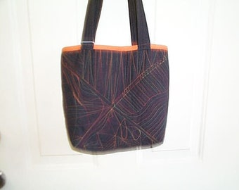 Black zentangle stitched bag with multi color stitches