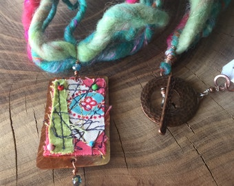 Hand spun fiber necklace with copper and fabric pendant