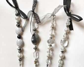 Silver and black bead ornaments