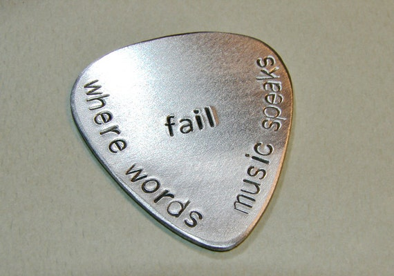 Handstamped aluminum guitar pick where words fail music speaks - GP943