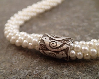 Tiny pearl bead crochet necklace with bird design sterling magnetic clasp