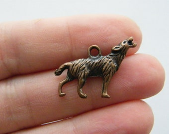 5 Howling wolf charms antique copper tone CC5