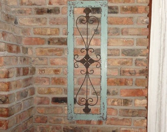 Framed metal wall decor, distressed metal, turquoise, garden decor, wrought iron, curvy scroll design.