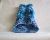 Dog sweater in blue multi with fur trim sizes m and l.