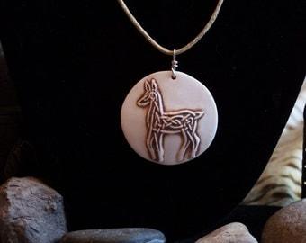 Handmade, relief carved porcelain Celtic Deer pendant/necklace