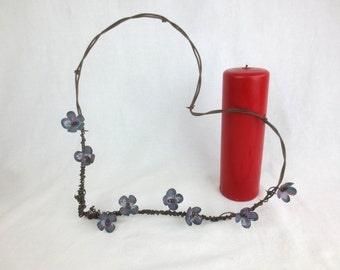 Barbed Wire Heart With Blue and Red Forever Blooming Flowers