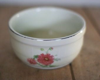 vintage hall bowl with floral motif and silver trim