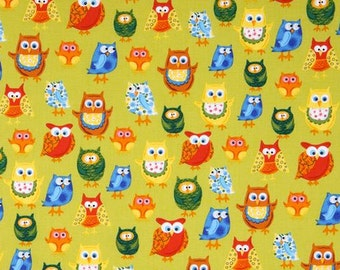 Woodland Friends 2 colorful owls on green -animal fabric from Clothworks