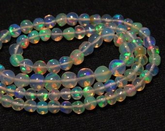 Welo Ethiopian Opal  - 13 Inches  -  Nice Quality Smooth Polished Round Ball Beads shape Full Color Full Flashy Fire size - 3 - 6 mm approx