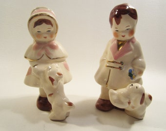 Vintage Boy and Girl Pottery Statues Puppies White Pink Brown Gold Trim
