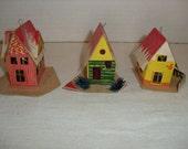 C) Three Small Cardboard Christmas Houses